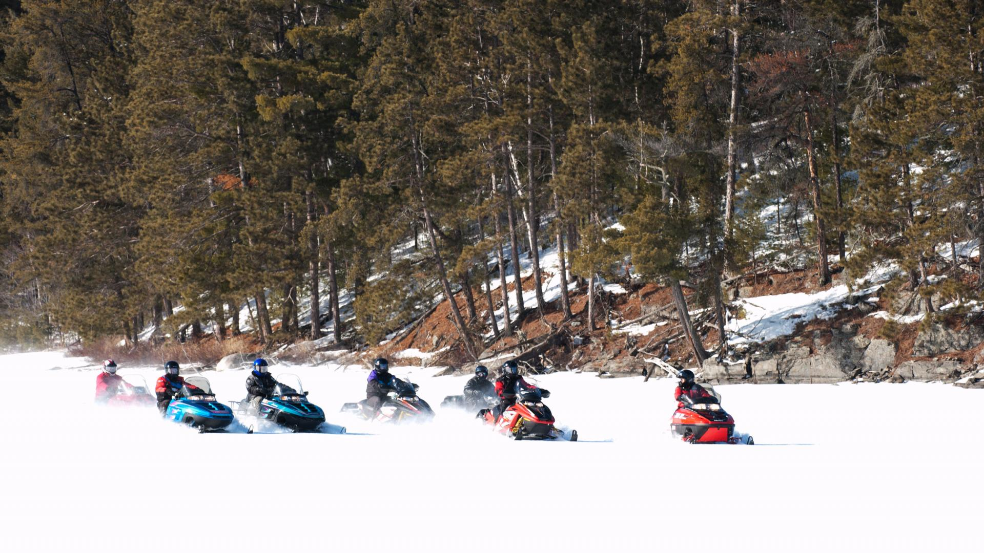 Group snowmobiling in Voyageurs National Park