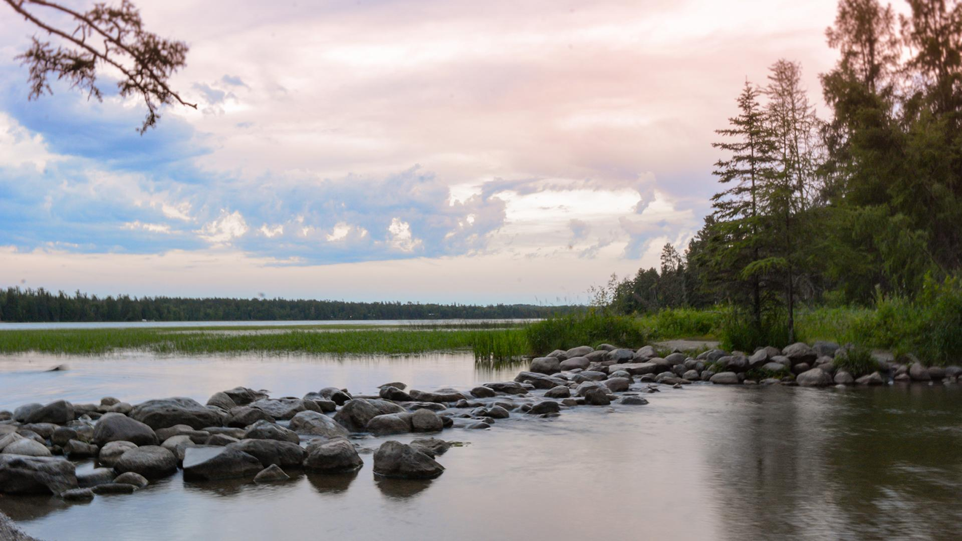 The Mississippi River headwaters under a pastel sky at Itasca State Park