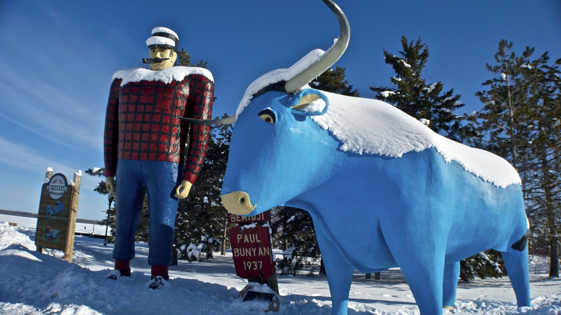 Snow-covered Paul Bunyan and Babe the Blue Ox statues