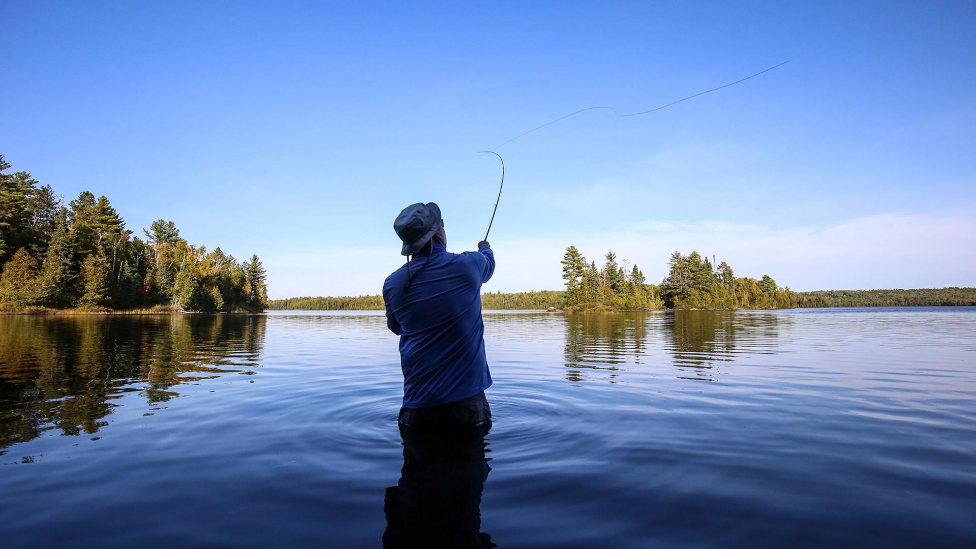 Fly fishing in the clear waters of Superior National Forest