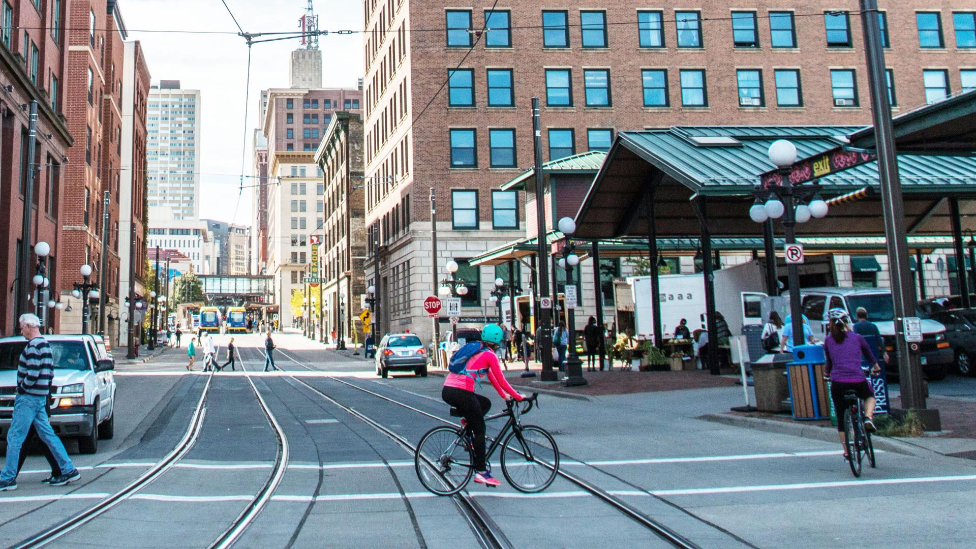 Woman biking in Lowertown St. Paul