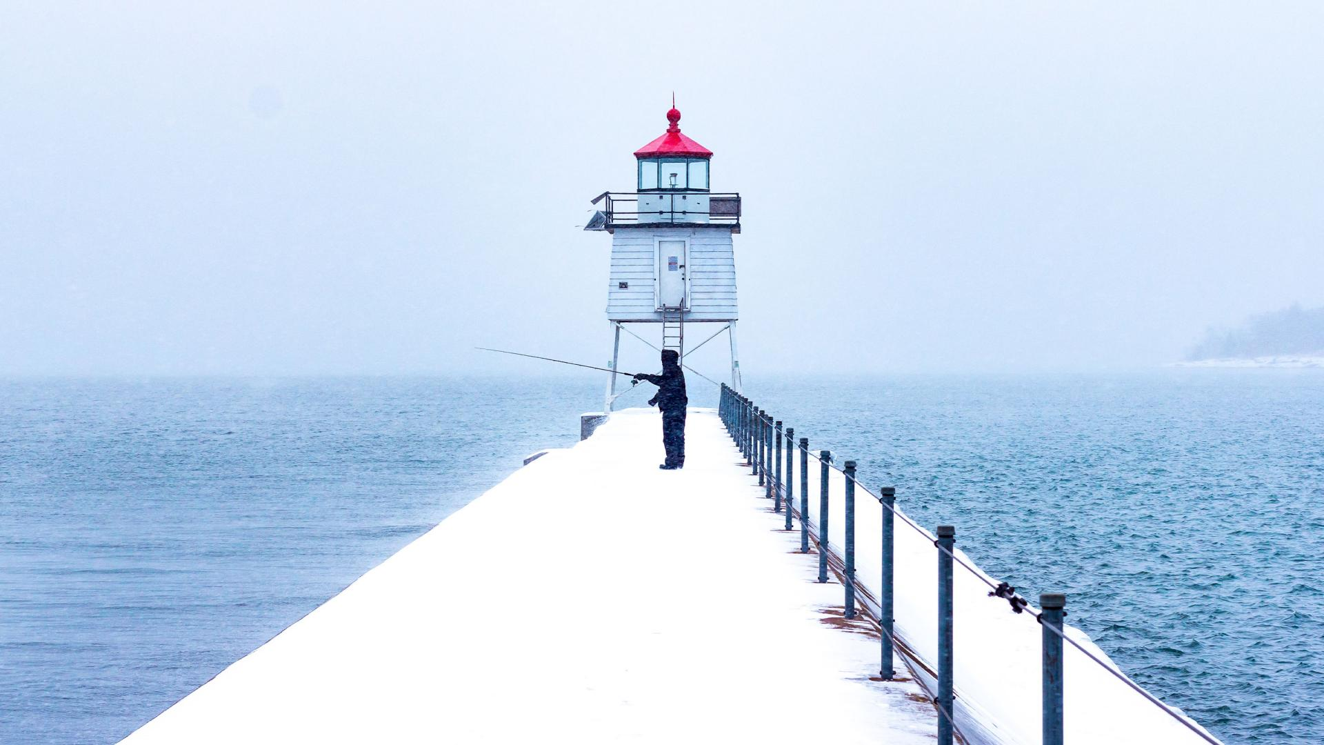 Winter fishing Lake Superior Two Harbors Lighthouse