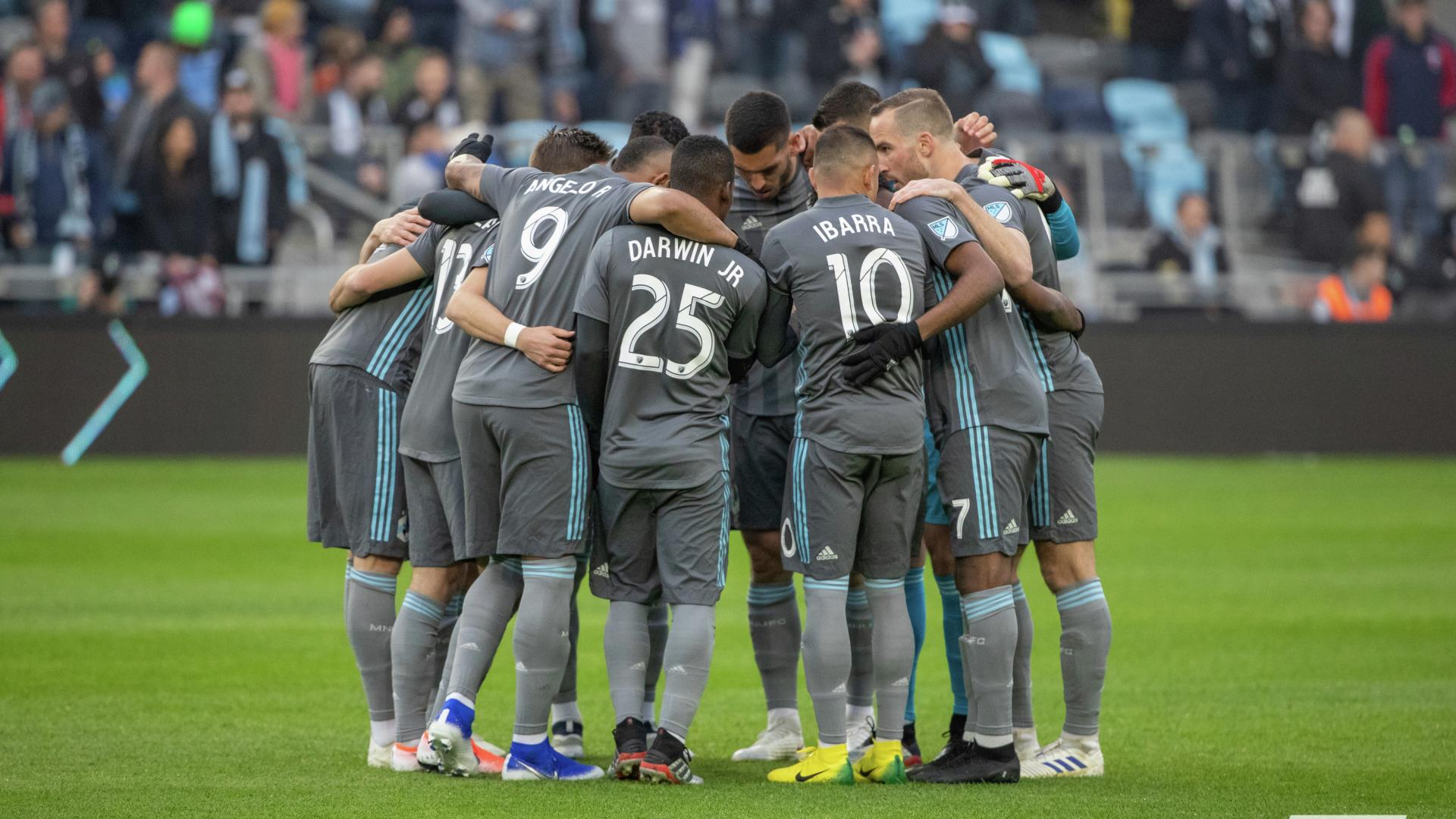 Minnesota United FC players in a huddle