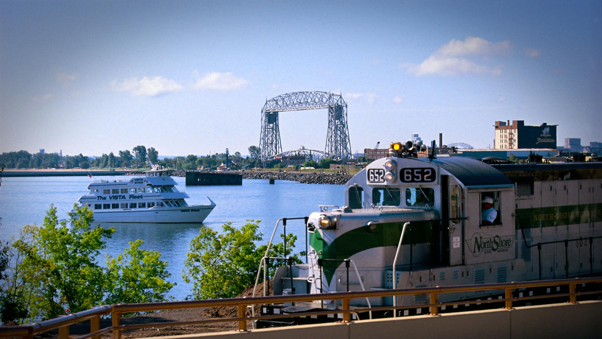 Duluth waterfront with train, boat and lift bridge