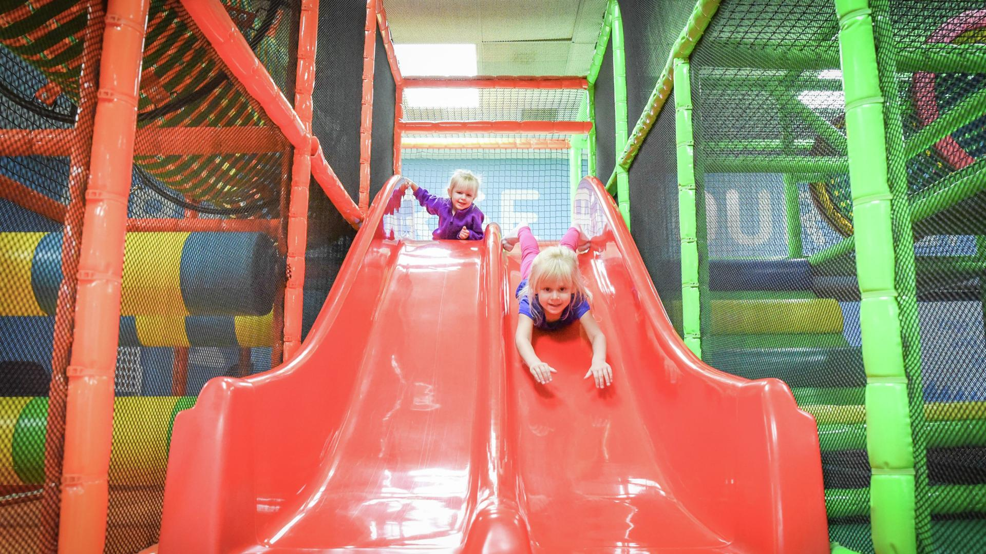 Kids on slide at indoor playground