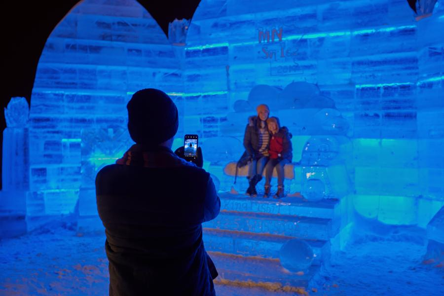 People posing for a picture in the ice palace at Detroit Lakes Polar Fest