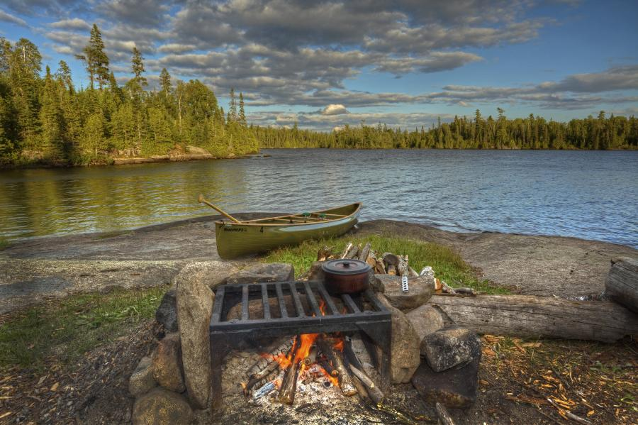 Boundary waters camp kitchen over a fire pit