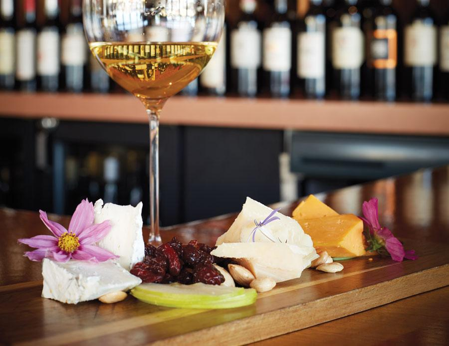 Cheese and nut platter with wine glass