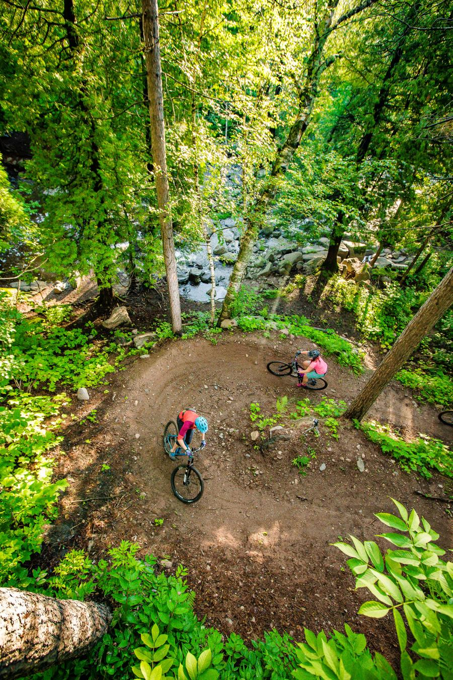 Overhead view of two mountain bikers on a wooded trail in Duluth