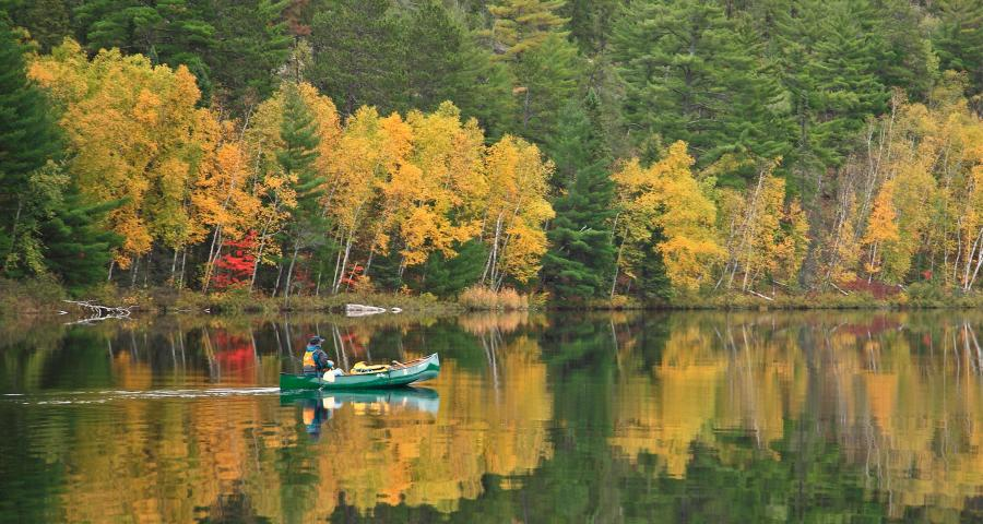 fall canoeing on lower pauness lake in the boundary waters