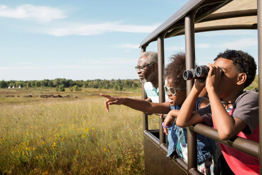 Family on bison buggy at Blue Mounds State Park