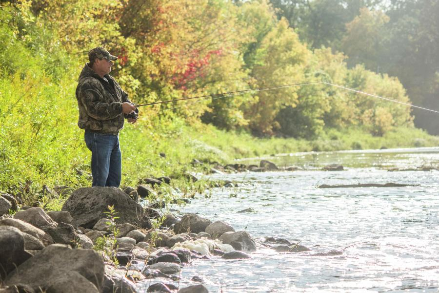 Man river fishing in the fall