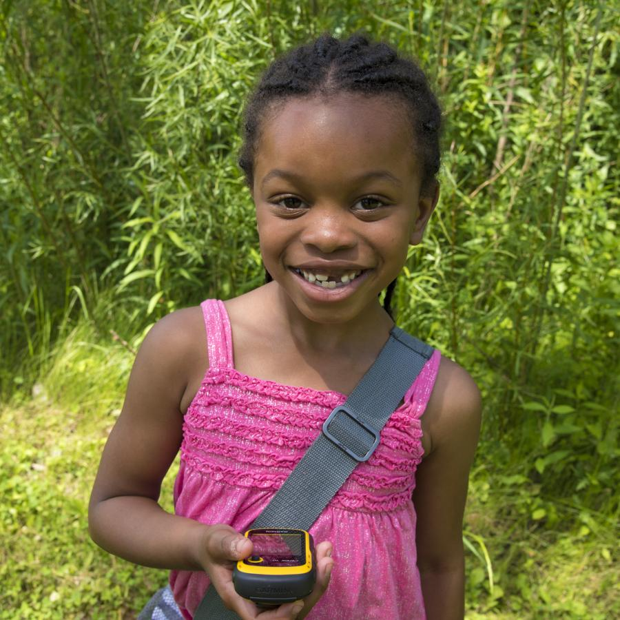 Girl with GPS device at Fort Snelling State Park