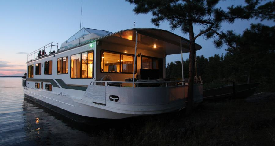 houseboat on rainy lake at sunset voyageurs national park