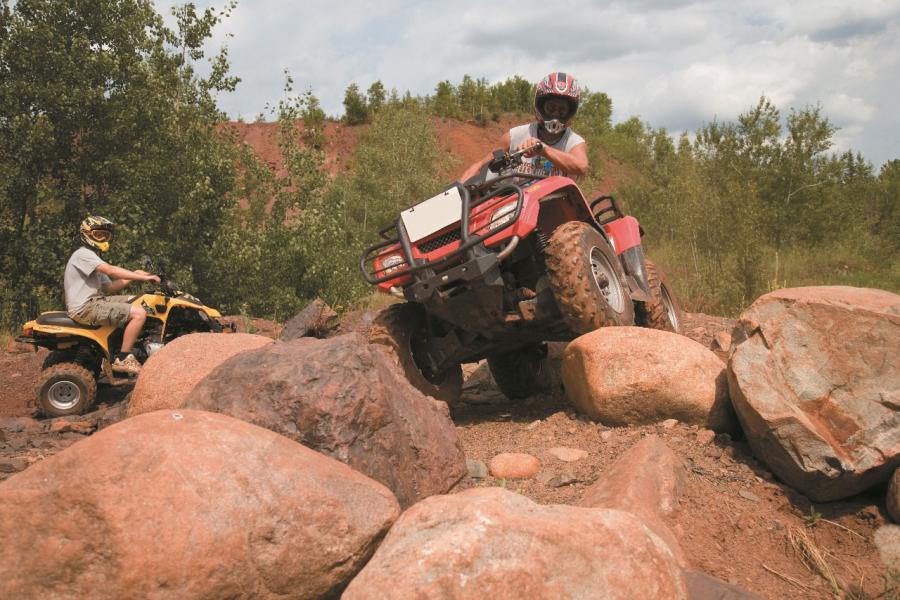 ATV rider rock crawling at the Iron Range OHV Recreation Area in Gilbert