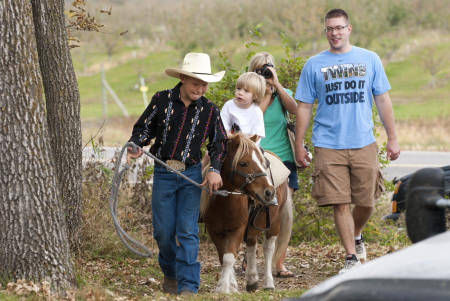 Child rides a pony at Apple Jack's Orchard