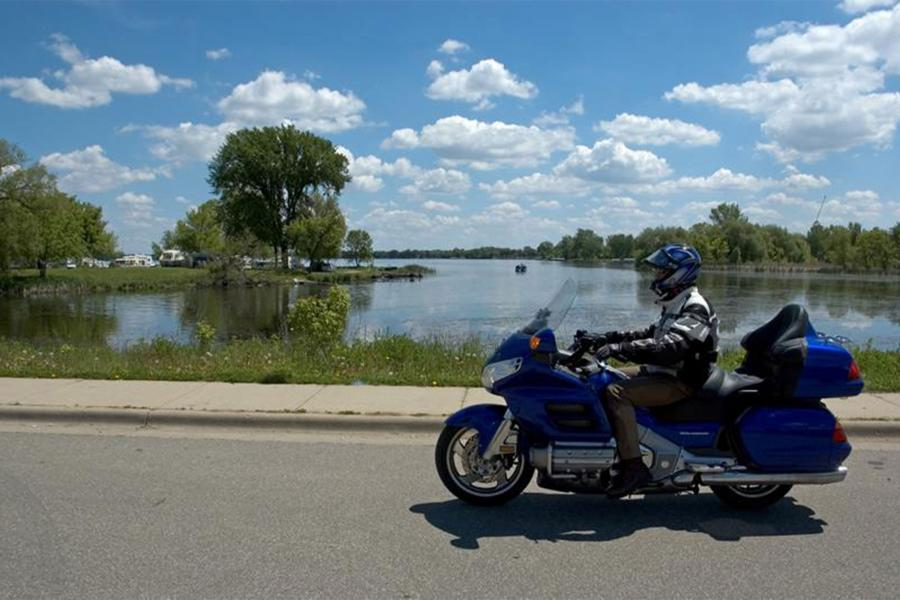 Motorcycle rider in front of lake