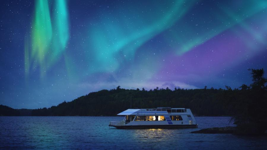 Northern lights over a houseboat in Voyageurs National Park