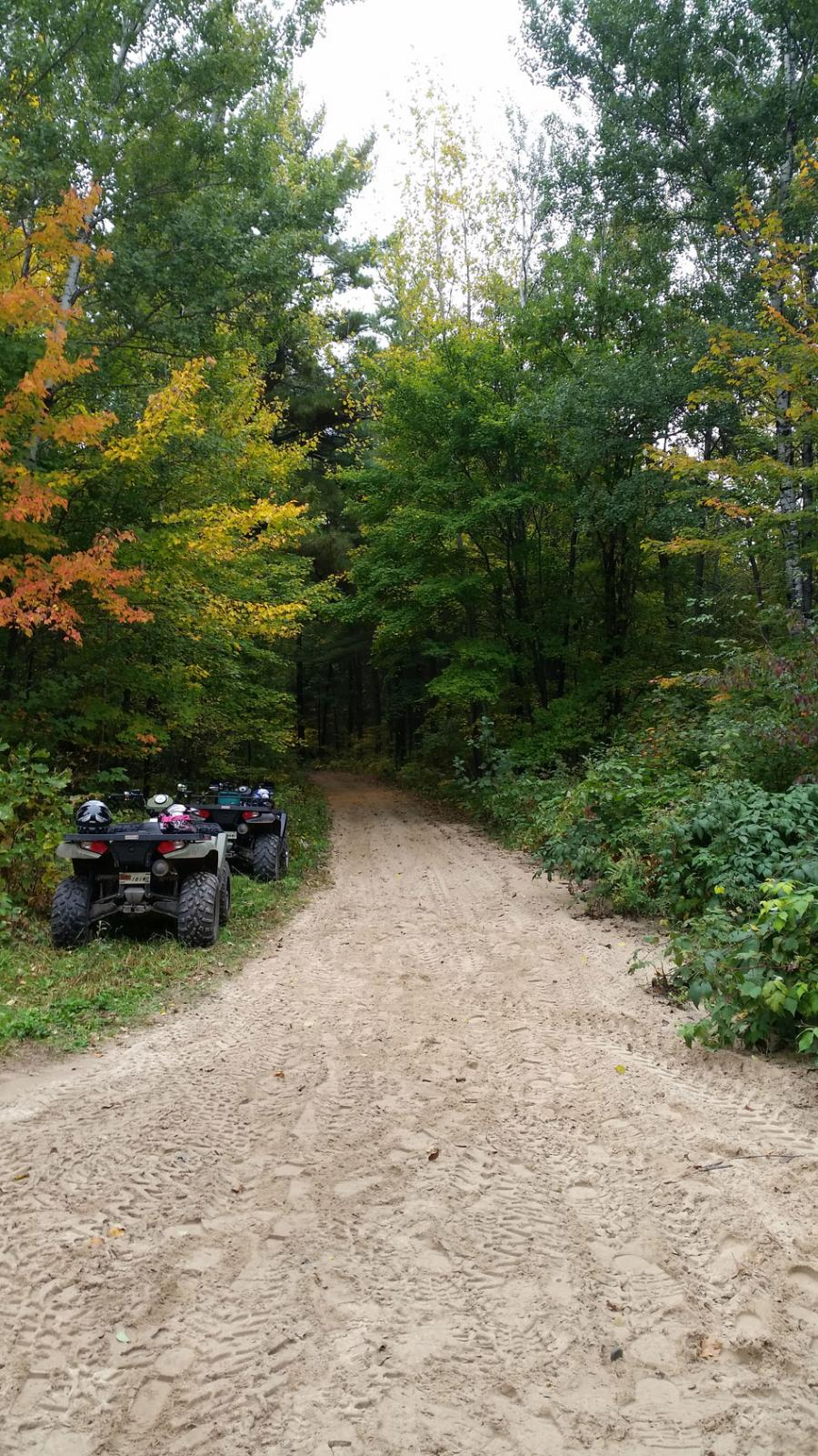 Two ATVs beside the Paul Bunyan State Forest trail