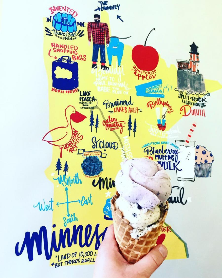 A ice-cream cone held up in front of a stylized Minnesota map
