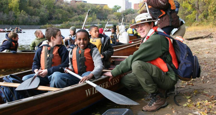 Ranger Brian with kids in canoes