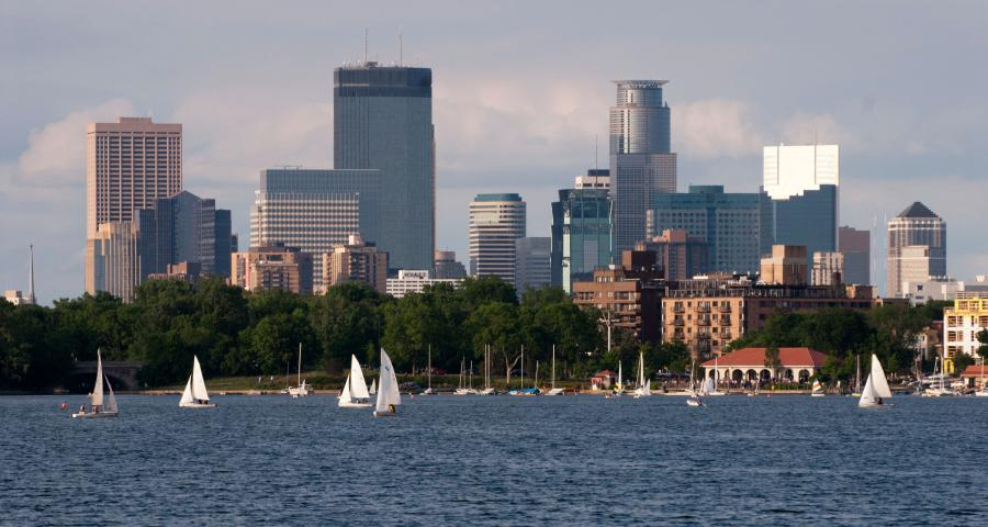 sailboats and skyline on minneapolis chain of lakes