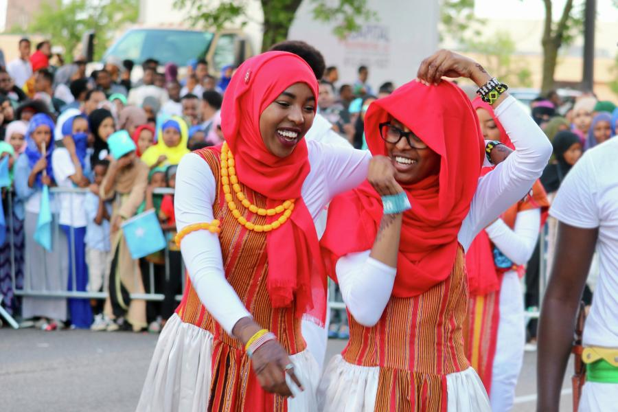 Two Somali dancers laughing