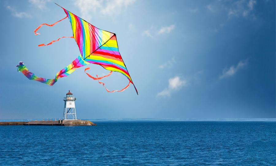 summer kite and lighthouse on lake superior in grand marais