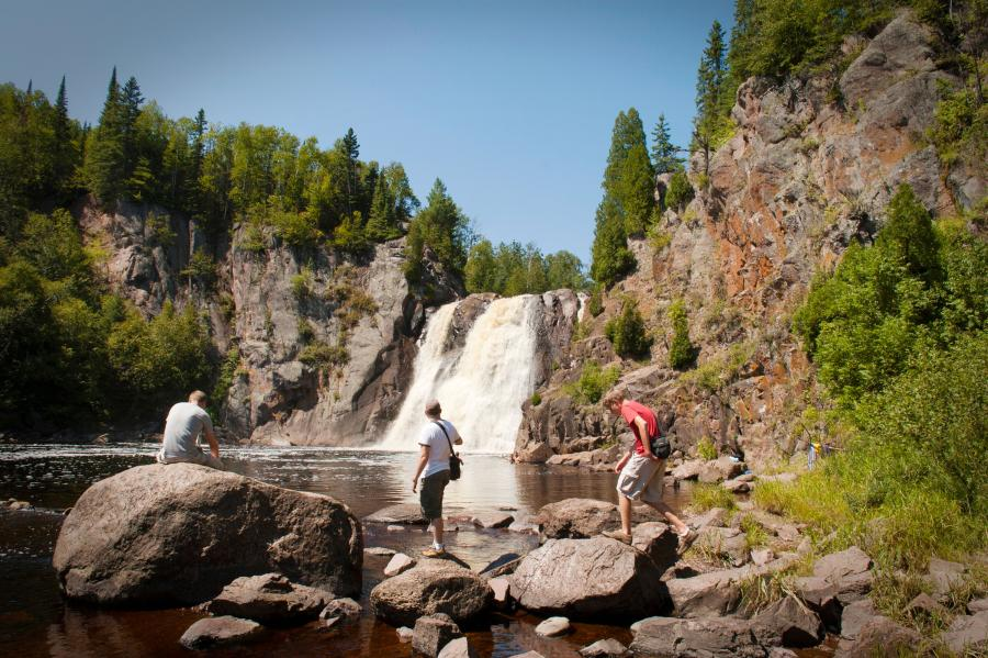 Three men observe the high falls at Tettegouche State Park