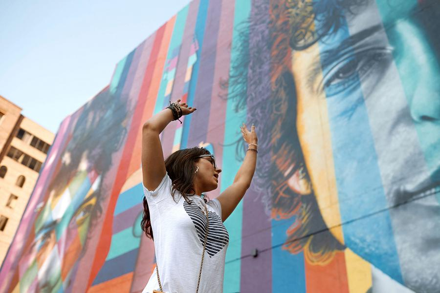 Woman in front of the Bob Dylan mural in downtown Minneapolis