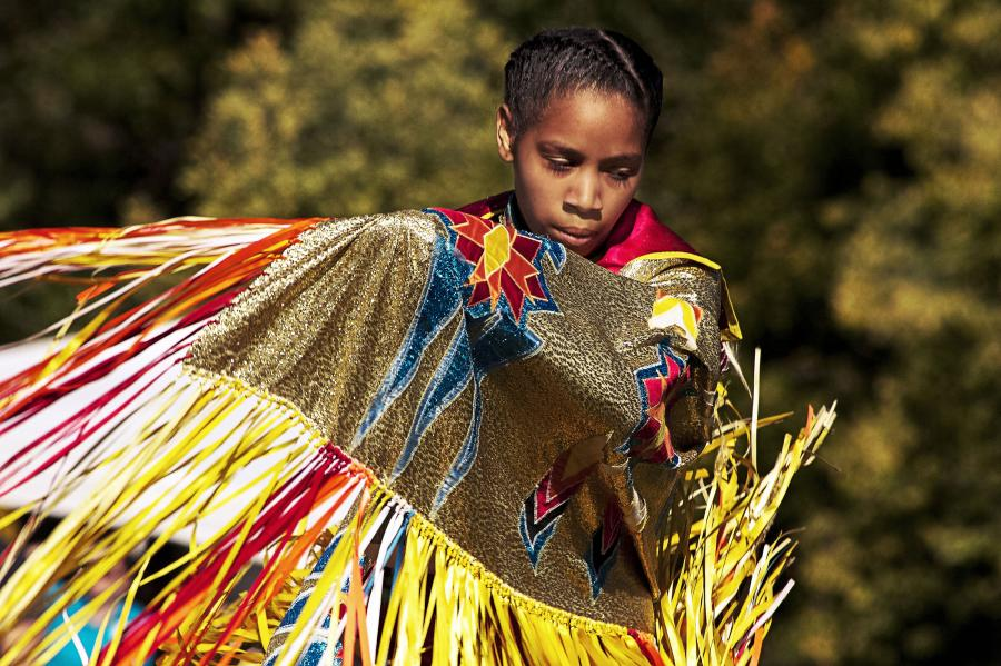 Young dancer in pow wow regalia