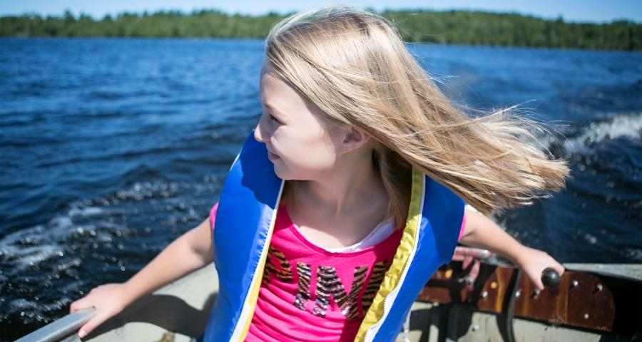 young girl on motorboat on lake vermilion