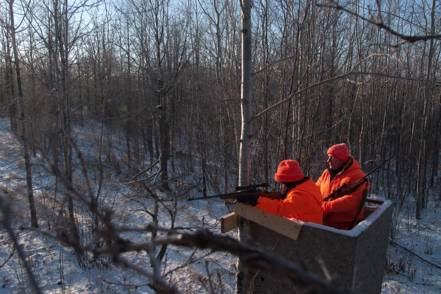 Father and son in deer stand