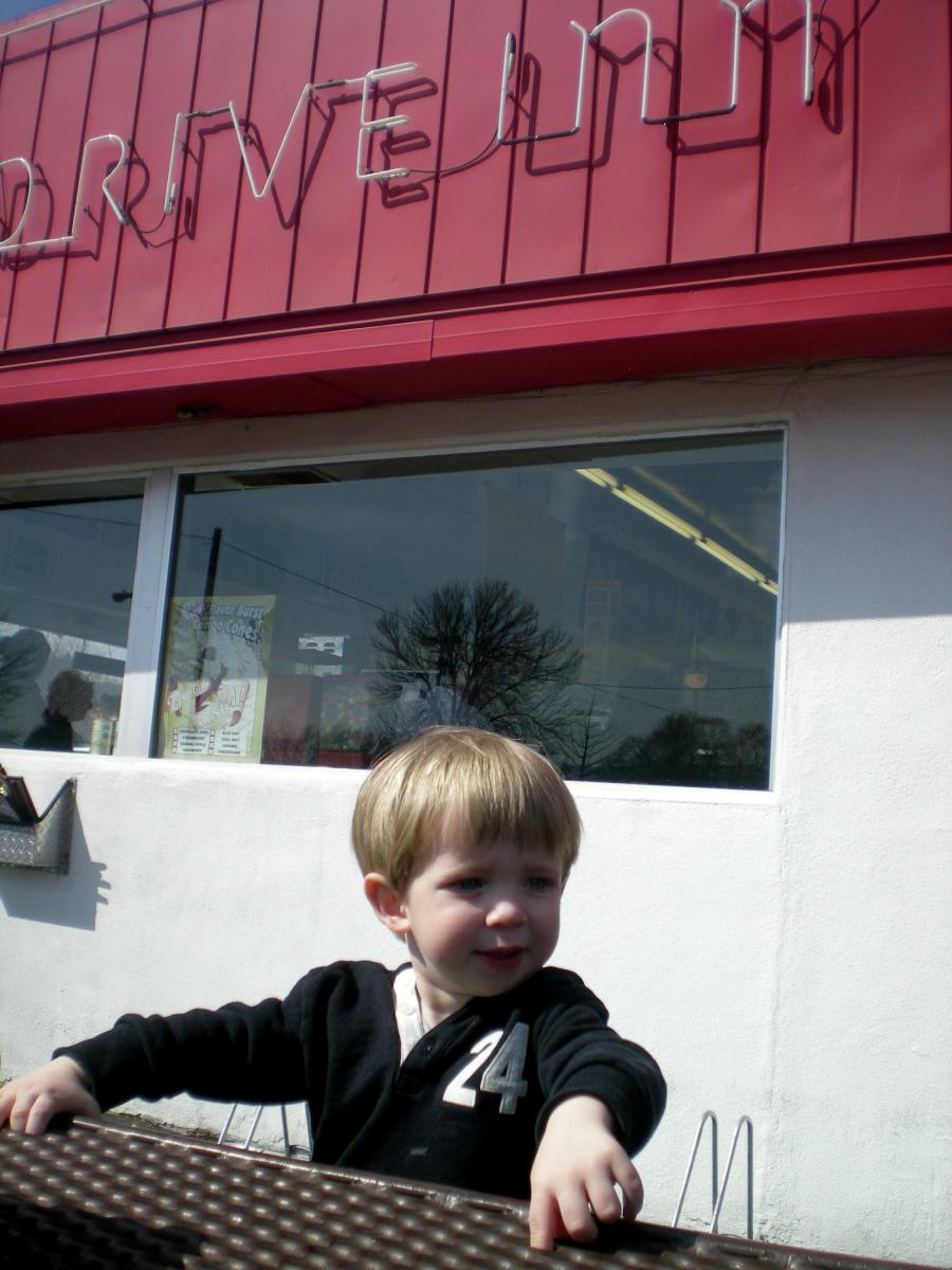 Boy outside a drive in restaurant