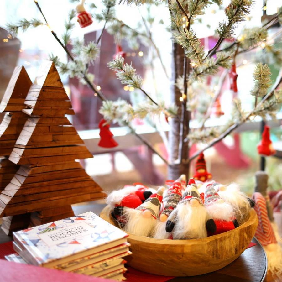 Holiday display with wooden Christmas trees and gnomes