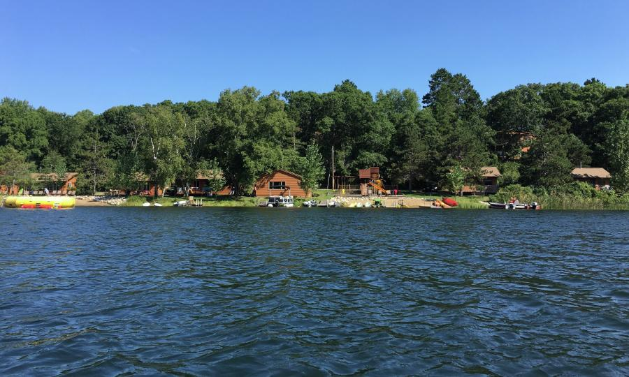 Cabins and beach on a lake from the water