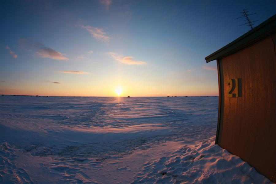 Winter sunset on Lake Mille Lacs ice fishing shack
