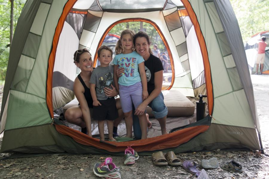 Family setting up their tent campsite