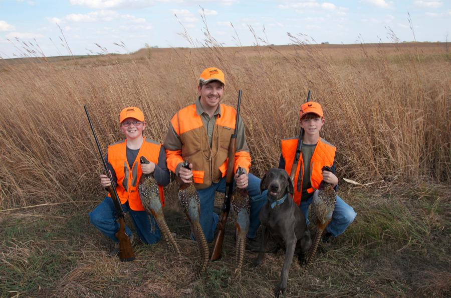 Father and sons pheasant hunting