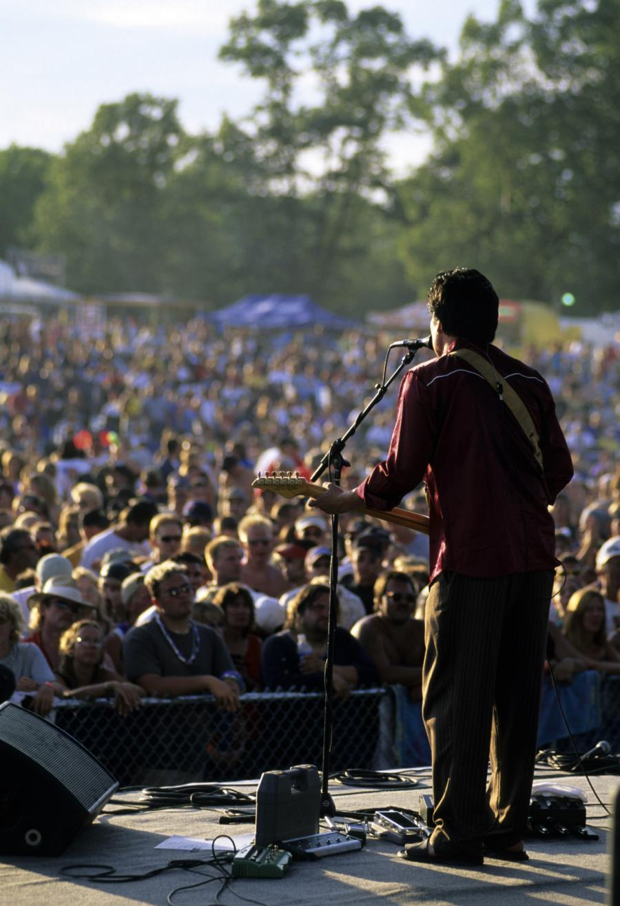 Moondance Jam singer on stage with large crowd