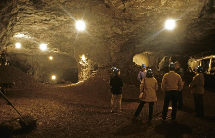 Visitors touring an abandoned iron ore mine