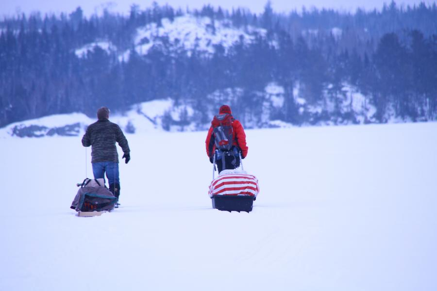 Two campers bring supplies into the Boundary Waters by sled