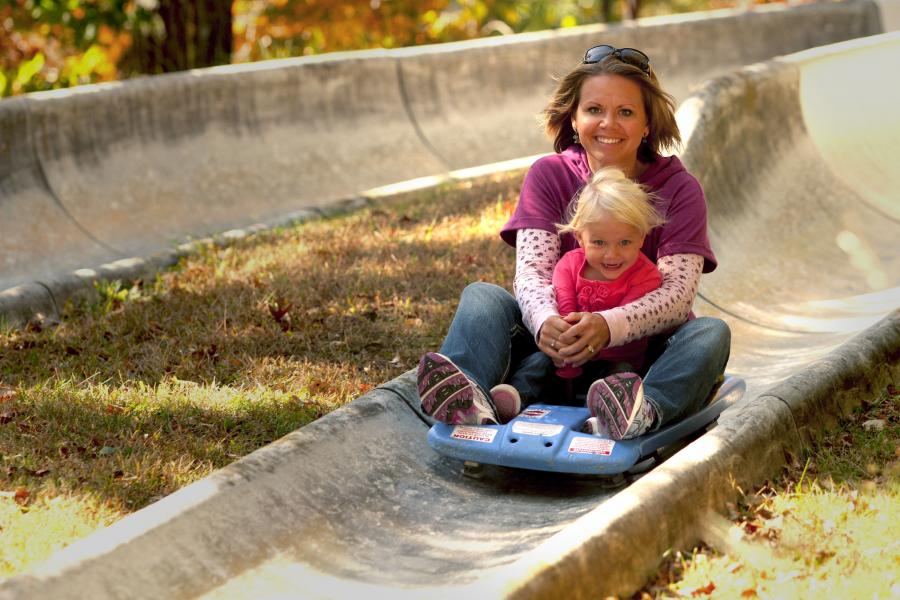 Mother and daughter on Alpine Slide at Wild Mountain