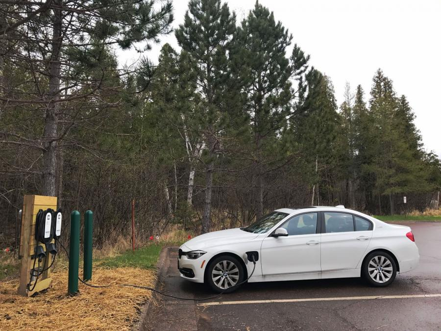 Electric Vehicle plugged into the fast-charging station at Gooseberry Falls State Park