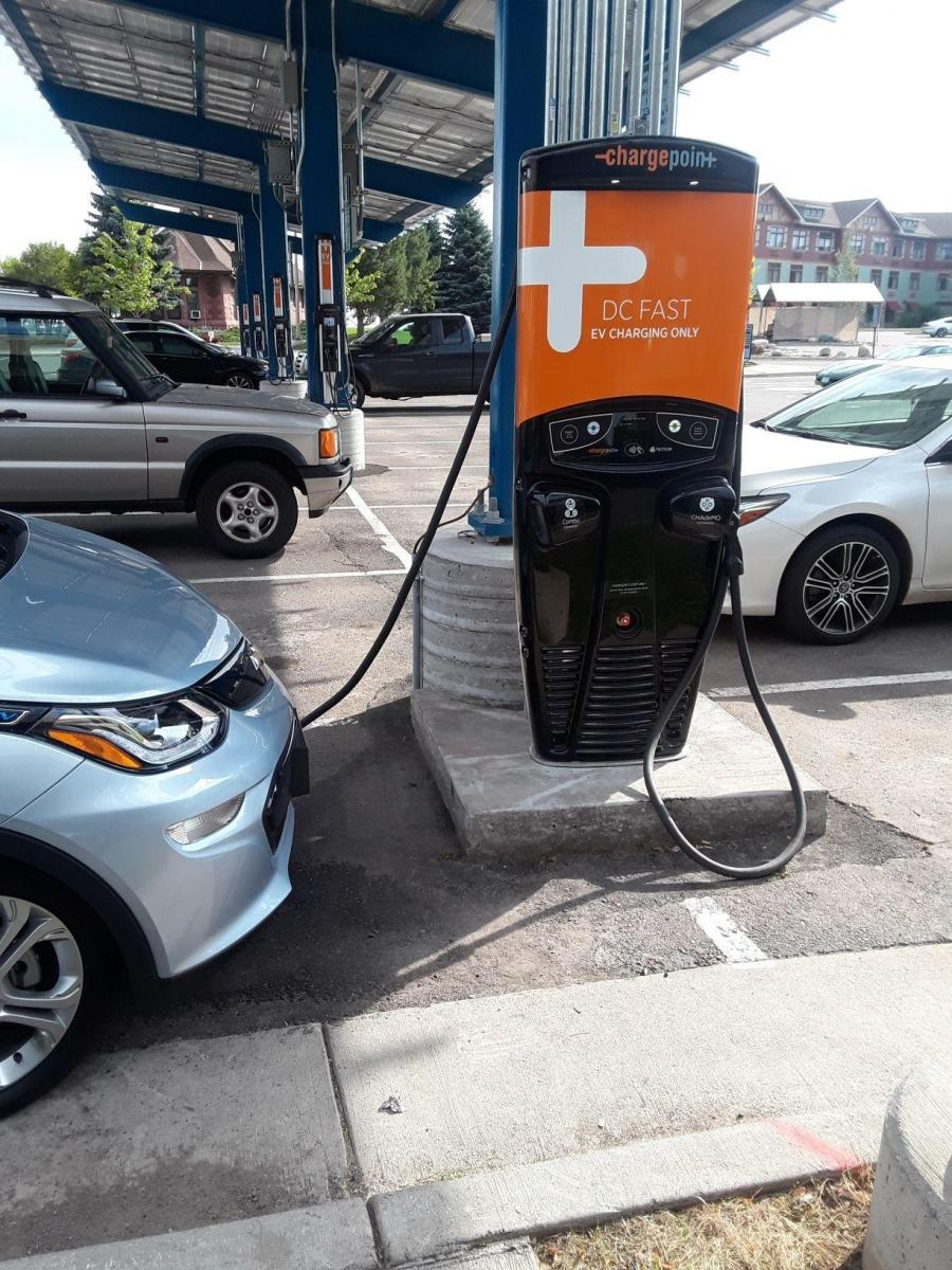 Car charging beneath the solar-powered charging station in Duluth