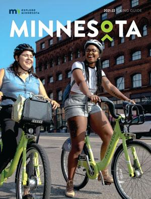 Explore Minnesota 20-21 Biking Guide cover featuring two girls on Nice Ride bicycles