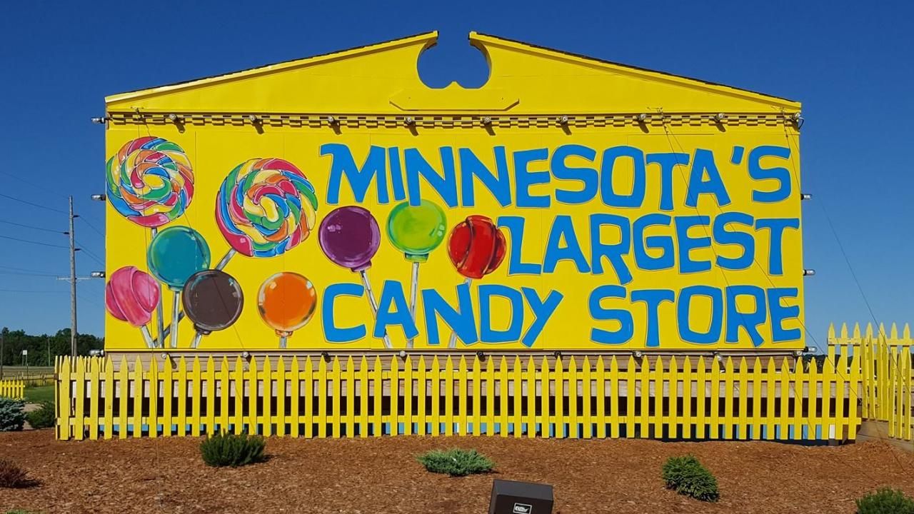 Yellow sign that says Minnesota's Largest Candy Store