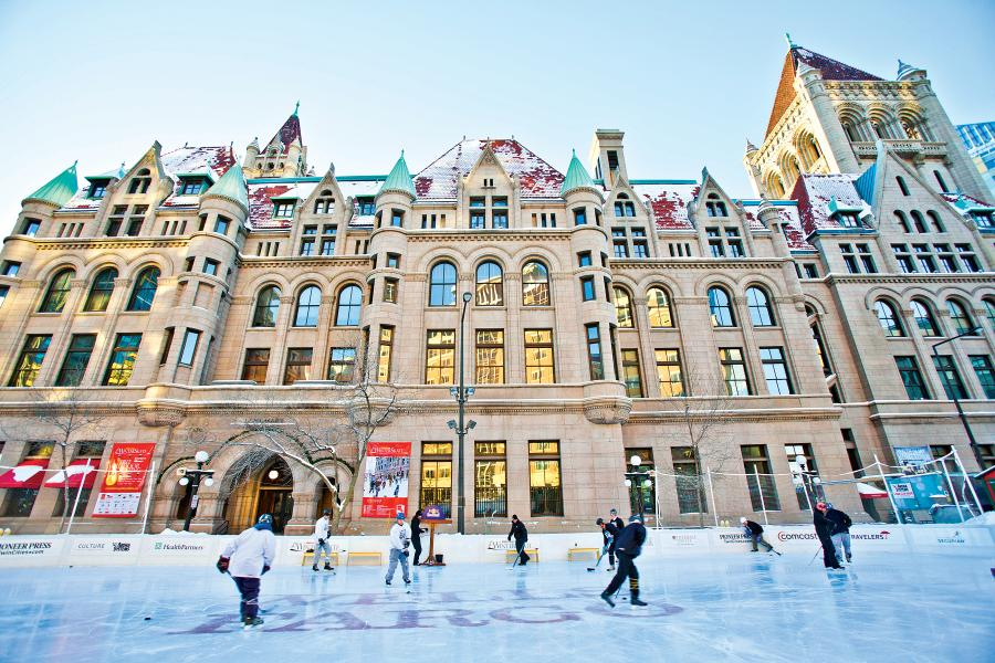Ice skaters in front of the St. Paul Landmark Center
