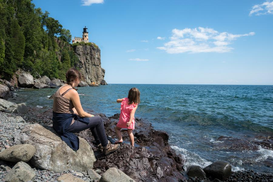 Mother and Daughter hiking to Spilt Rock Lighthouse on Lake Superior in the Spring/Summer