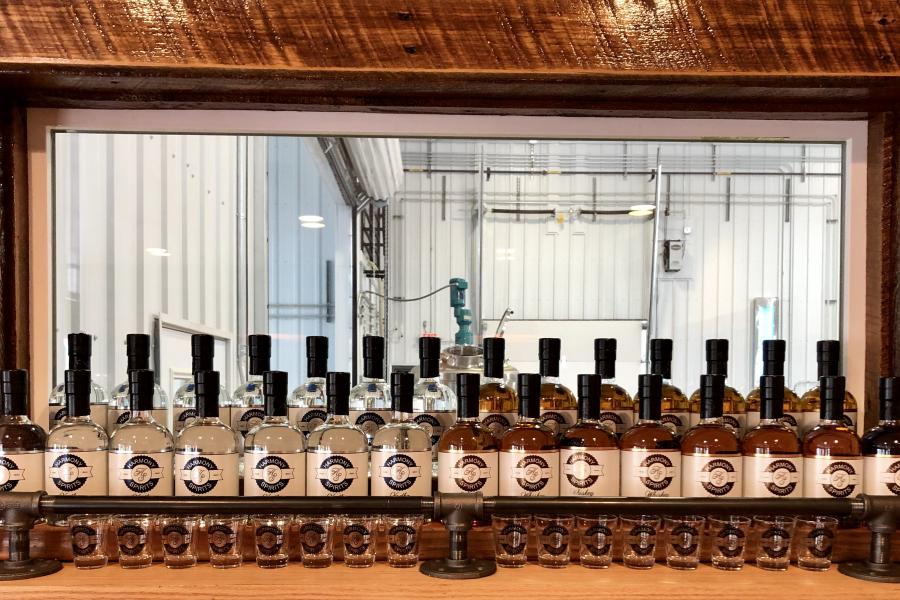 Bottles of whiskey, vodka & bourbon at a distillery